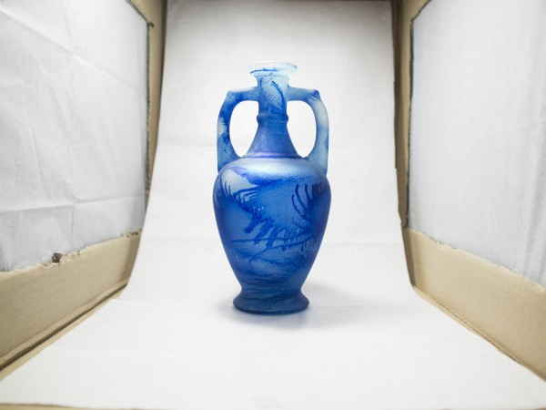 A blue vase is set up inside the lightbox. A bright white light is evenly dispersed throughout the box.