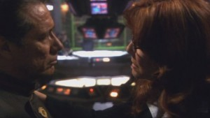 Roslin and Adama in profile, with the bridge in the background