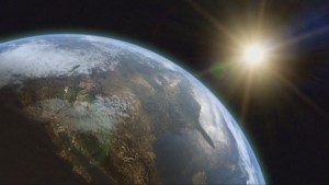 A shot of Earth from outerspace - most of the United States is visible. A bright light is in the upper right corner.