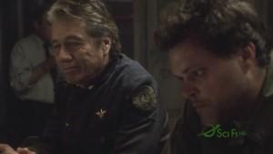 Adama and Tyrol sit at the bar.