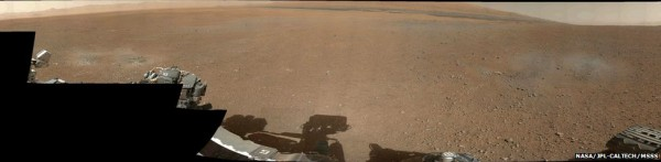 Low-res panoramic picture of Gale Crater on Mars, with Mount Sharp visible at the center.