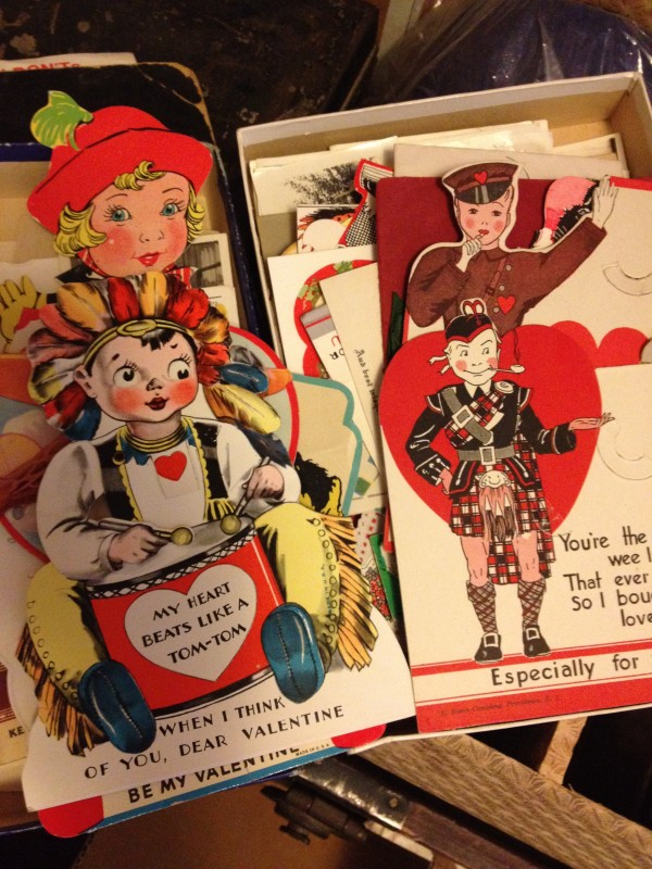 photos of vintage valentines featuring a child in a Native American head piece, a soldier, a small girl in a bonnet
