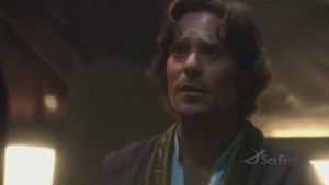Baltar, wearing some sort of robe, and looking enlightened.