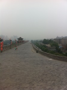 Bricked top of the city wall, with pollution haze in the distance
