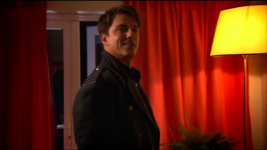 Captain Jack Harkness, half-smiling.