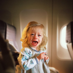 Screaming little girl on an airplane