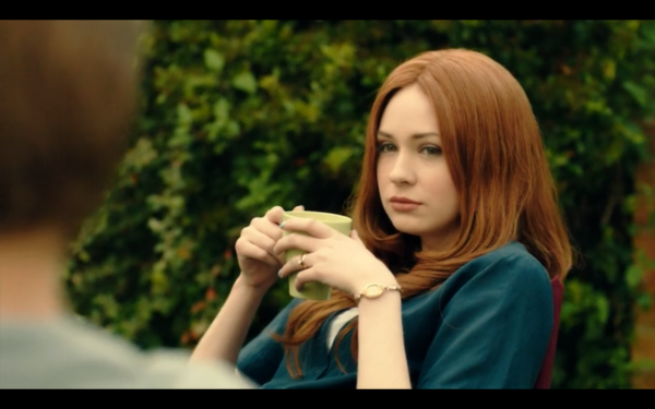 Amy Pond in her yard, holding a mug
