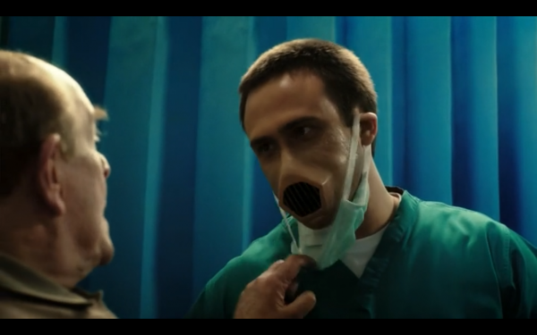 Patient pulls down a doctor's mask to reveal a vent where his mouth should be