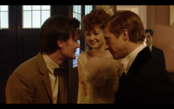 The Doctor, Amy, Rory, and the TARDIS at the Savoy. Amy and Rory are in period clothing from 1890; all look very happy.