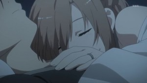 Kirito and Asuna cuddling. She has her head on his shoulder.