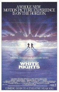 Movie poster for white nights, with two small silhouettes of men running on snow against a sunset