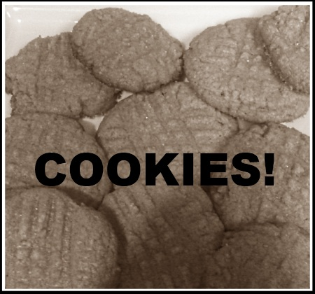 "Plate of peanut butter cookies with ""cookies!"" in bold text."