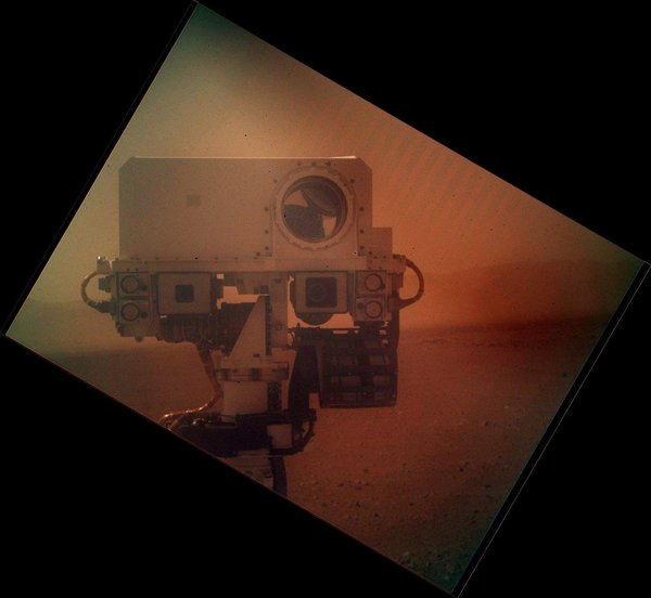 Picture of the Curiosity rover's mast as taken by one of its cameras and rotated by NASA, with Martian horizon in background