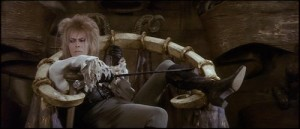 """David Bowie as Jareth from """"Labyrinth,"""" with a sneer on his face."""