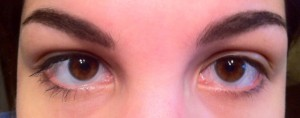 Closeup of eyes with one coat of mascara on left eye and none on right eye
