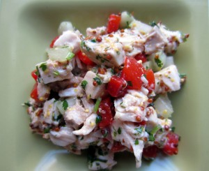 Bowl of chicken salad with chopped red peppers