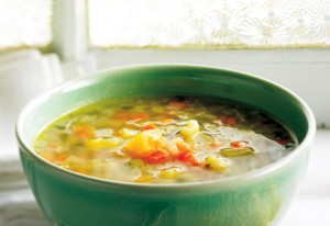 Large green bowl filled with a vegetable soup