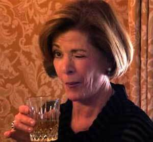 Lucille Bluth winking with a drink in her hand