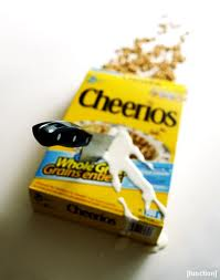 Cheerios box with a butcher knife sticking out of it, milk spilling out around the knife wound, and cereal spilling out of the top of the box