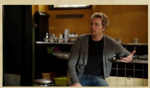 Crosby sits on a stool in the Luncheonette