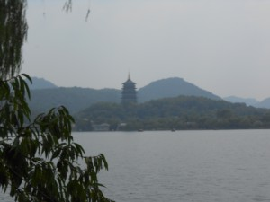 Lake with mountains and a pagoda on the far shore