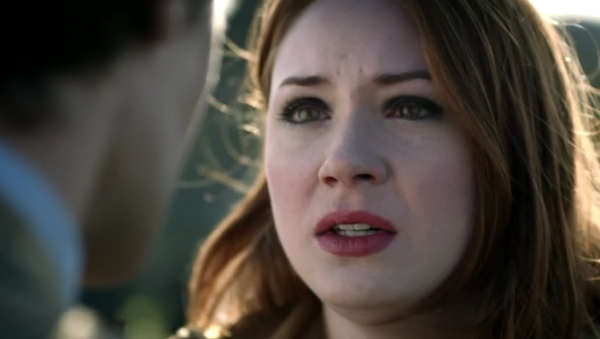 Amy Pond, a red-head with pale skin, dark eyebrows and eye makeup, reddish lips, and a very faint blush