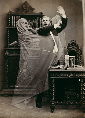Old photograph of a man being grabbed by a ghostly robed figure with a skull