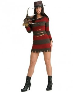 Woman in a mini-dress version of Freddy Kruger's costume, with a hat, ankle boots, and one hand with claws