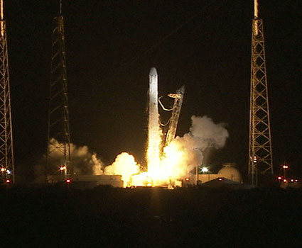 Falcon 9 rocket blasts off from the launch pad at night