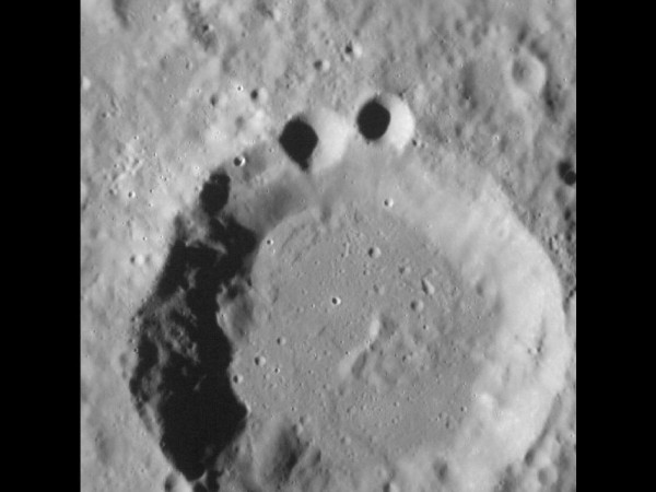 large crater with two tiny craters on the upper rim that make it resemble Cookie Monster