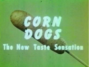 "Vintage picture of a corn dog with superimposed text reading"" Corn dogs: The new taste sensation"""