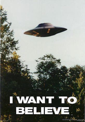 """Round UFO hovering over trees, captioned """"I want to believe"""""""