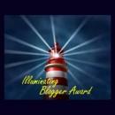 """Image of a lighthouse, captioned """"Illuminating Blogger Award"""""""