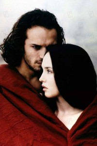 Man and woman wrapped in a red blanket