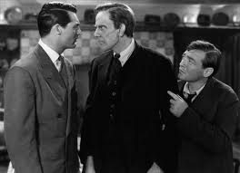 Still from Arsenic and Old Lace of three men talking