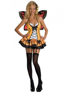 Woman in a yellow corsetted mini-dress, black thigh-highs, and monarch butterfly wings