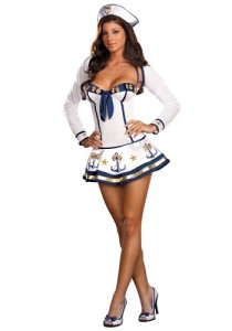 Woman in a white mini-dress with blue piping and anchors adorning the skirt, with a sailor hat and high heels