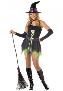 Teen girl wearing a short witch dress, witch hat, armbands, and knee-high boots, holding a broom