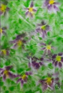Andrae's fabric is chiffon, sprayed with abstract purple flowers with yellow centers, on a field of impressionist-esque green leaves.