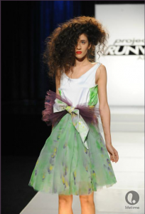 Project Runway All Star contestant Andrae's outfit, a knee length sleeveless dress with a full skirt made from spray painted chiffon.