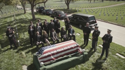 A screenshot from the TV show Bones: a military funeral