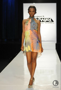 Project Runway All Star Cassanova's dress is an above the knee halter dress with a pastel watercolor background featuring bolder colored city-inspired stencils.