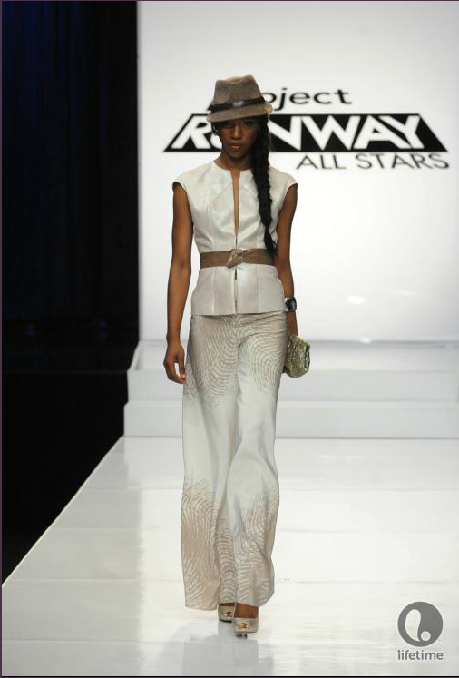 Project Runway All Stars 2x04 designer Cassanova's model is wearing a two-piece pantsuit in flowing white fabric.