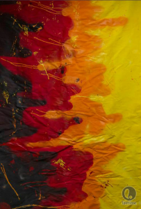 Emilio's fabric is made of bold swatches of yellow, orange and red on a black background. It resembles the corona of the sun.