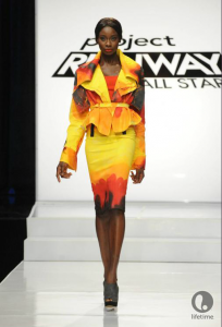 Project Runway All Star contestant Emilio's red, yellow and orange power suit for the 21st Century.