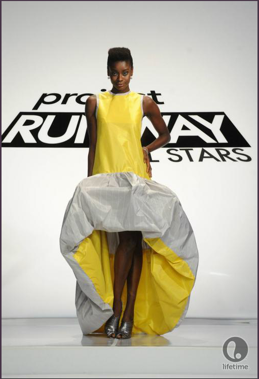Project Runway All Stars 2x04 designer Emilio's model is wearing a party dress with a dramatic dropped waist and ruffled bubble skirt.