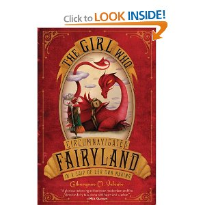 red book entitled The Girl Who Circumnavigated Fairyland in a Ship of Her Own Making with a picture of a dragon on it