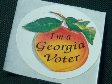 "Sticker with a peach on which is written ""I'm a Georgia voter"""