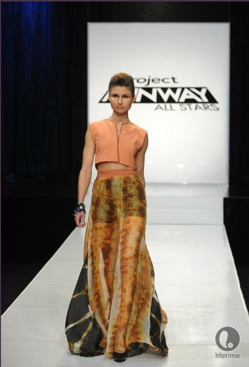 Project Runway All Stars 2x04 designer Ivy's model is wearing a cropped, loose fitting top over a long, flowing skirt made from a lightweight, gauzy fabric.