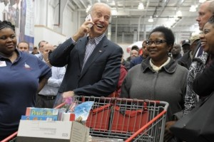 Image of Joe Biden Shopping at Costco, while laughing and talking on an employee's cell phone